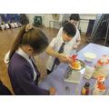Carefully weighing ingredients.
