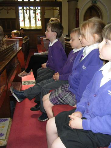 Sitting comfortably on the pews.