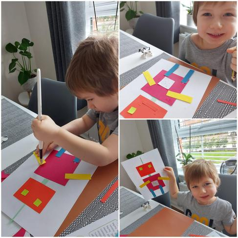 Kacper making his robot out of squares and rectangles.