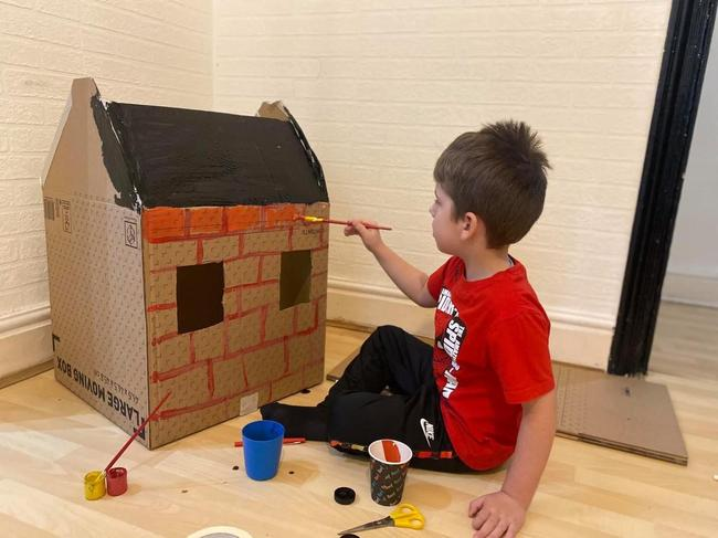 Very creative - painting a house for one of the little pigs