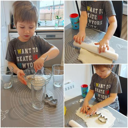 Kacper making animal biscuits.