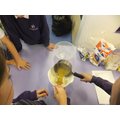 Mixing wet and dry ingredients.
