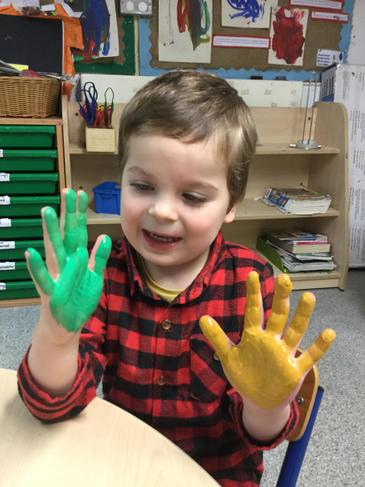 Remy enjoyed making hand prints.