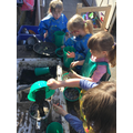 We love getting messy in the mud kitchen.