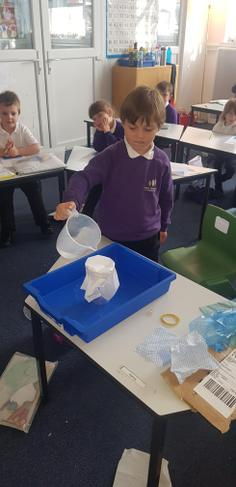 Investigating which materials were waterproof.