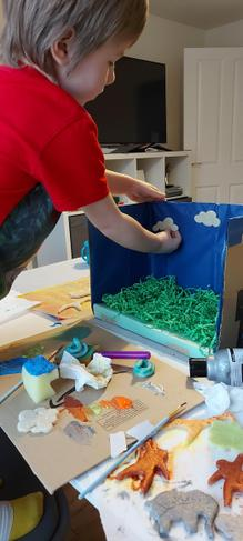 Kacper making his rainforest diorama.