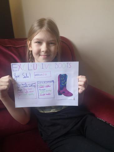 Here is K's persuasive poster for her own boots!