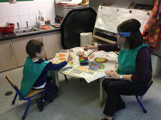 Remy and Mrs Davis creating their Beautiful Oops pictures for Mental Health Awareness Week