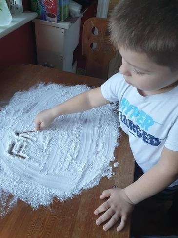 Messy play - writing names in flour