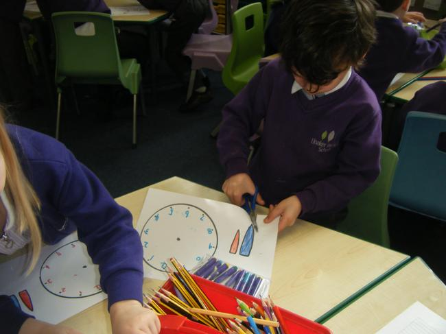 The we coloured in the hour and minute hands.