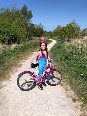 Savanna out enjoying the sunshine on her bike