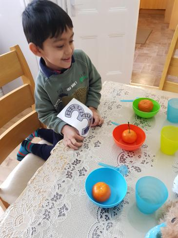 Zidan set the table using 3 bowls, 3 cups and 3 snacks for his teddy bears.