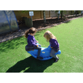 The small children love the seesaw