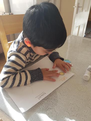 Zidan creating his day and night poster.