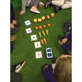 Counting fruits and vegetables and learning how to represent them with the numerals.