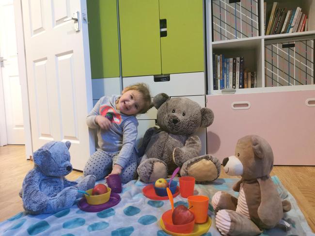 Lena with her teddy bears.