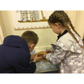 Emily and Jay learning to be engineers.