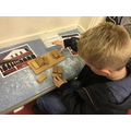 Alfie working out how to build a strong bridge..