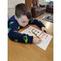Ethyn working hard on his maths