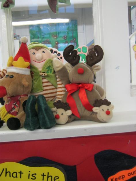 The Elf is in-between the reindeer.