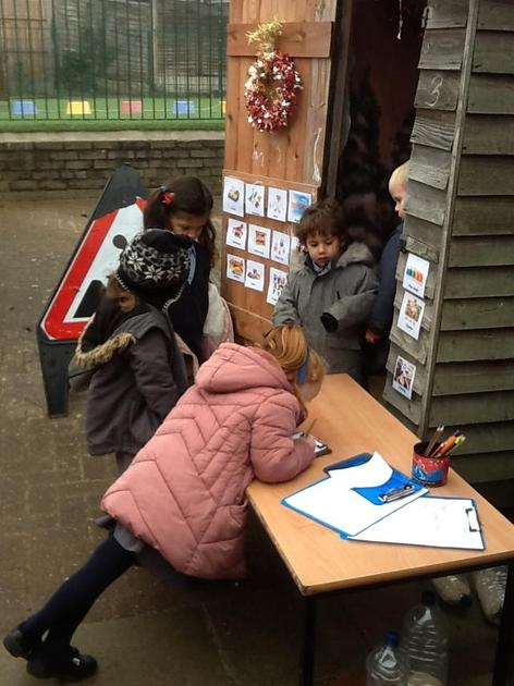 Writing letters to Santa in out grotto