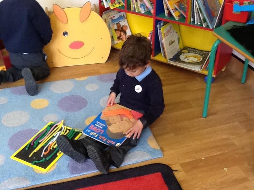 Reading a book about families.