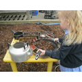 Busy cooking in the mud kitchen