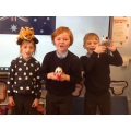 Amber, Oliver G & Oliver T caring for their joey at school