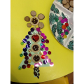 We made patterns on our Christmas tree shapes.