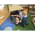 Sharing and taking turns in a big box