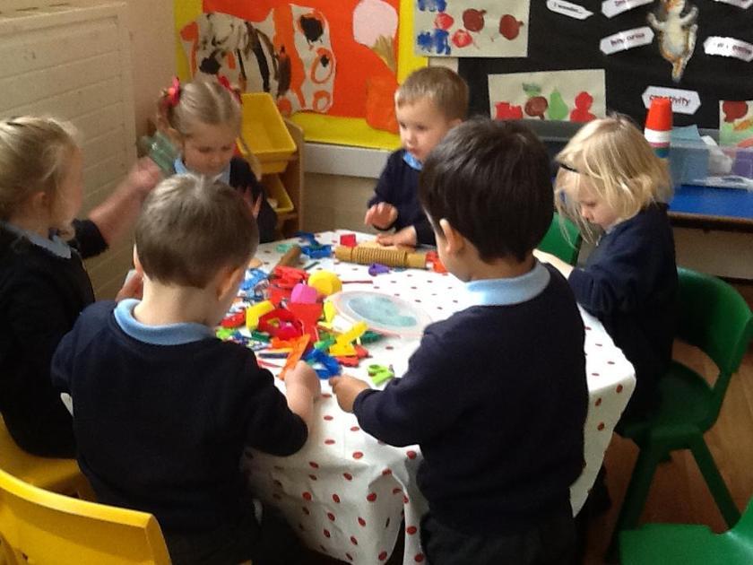 Sharing the pumpkin colour playdough.
