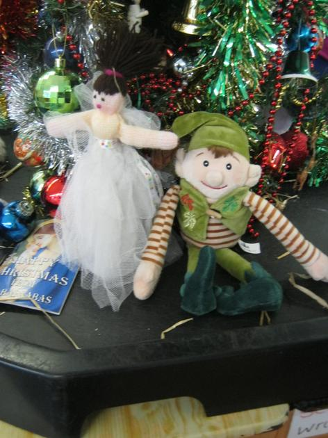 The Elf is next to the Angel.