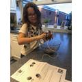Jessica making her bird feeder