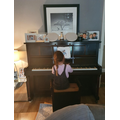 ...and playing the piano!