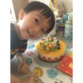 Lucas has got a delicious cake to eat.