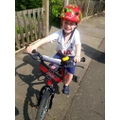 Clarke has been learning to ride a bike.