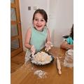 Alexandra has been mixing dough to make pizza.