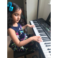 Amaira is learning to play the piano in lockdown.
