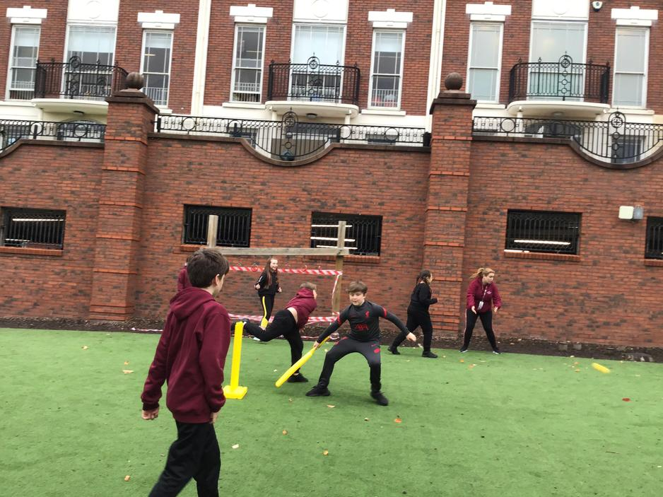 PE- playing cricket