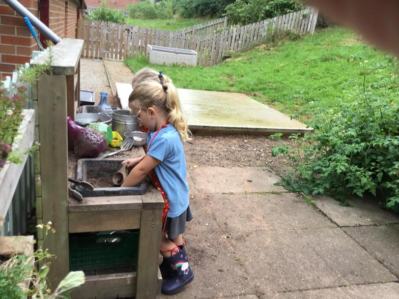 Making a home for some worms in the mud kitchen.
