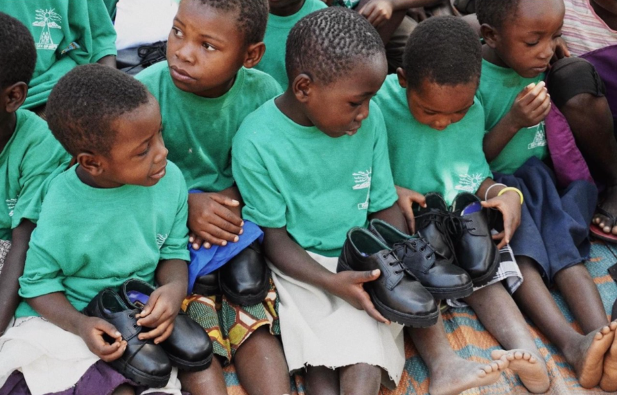 Last summer's DT workshops raised money for shoes which have made it to the children.