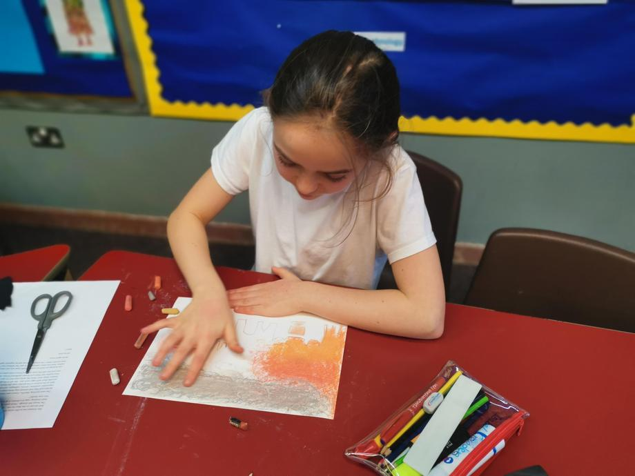 Creating our Blitz inspired art using oil pastels.