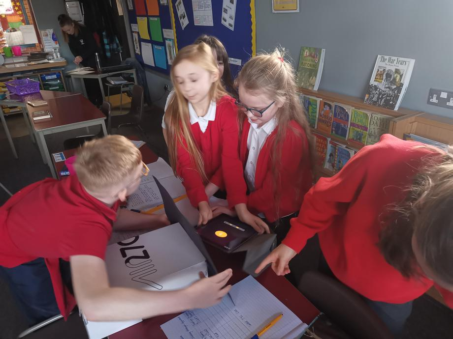 Carrying out our science investigations to see which material best blocks out light!