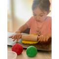 Making her own playdough!