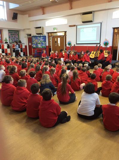 Criw Cymraeg leading an assembly.