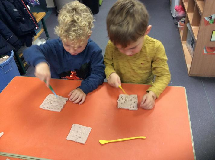 Creating Rangoli patterns in the play dough