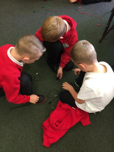 The boys worked together to solve the problem.