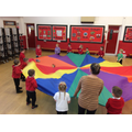 Having fun using the parachute with our pets