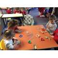 Making shaped flags in the playdough