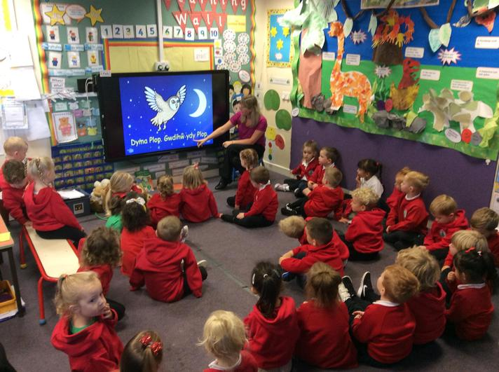 Enjoying a welsh story about Plop the owl